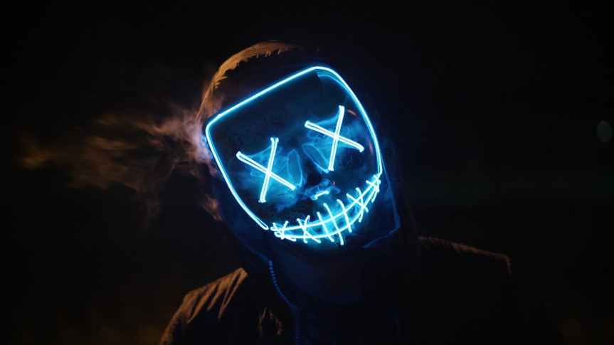 man wearing black and blue mask costume